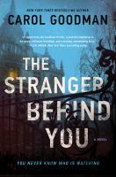 The stranger behind you : a novel Book cover
